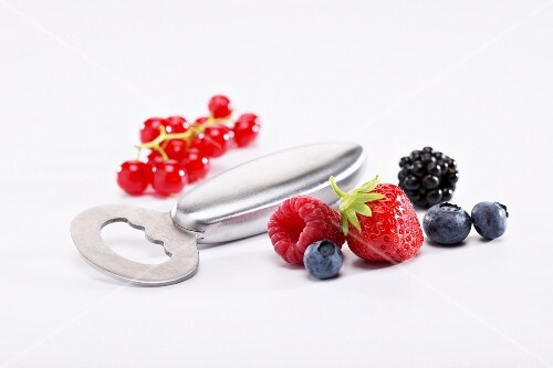 A bottle opener and fresh berries