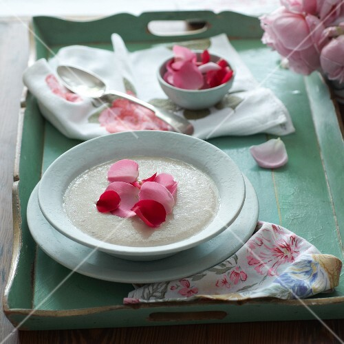 Soup with rose petals on a tray