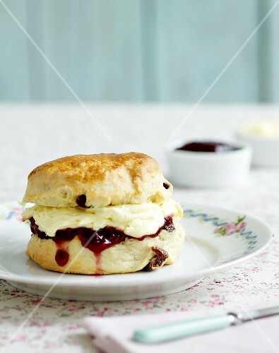A scone with clotted cream and jam