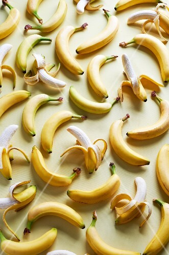 Lots of bananas, whole and partly peeled