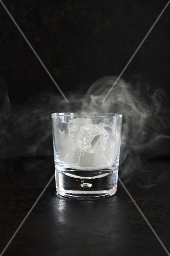 Smoking Ice in a Glass; Black Background