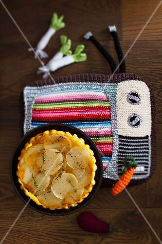 Turnip tarte tatin on a crocheted place mat