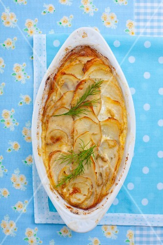Potato gratin with fennel leaves