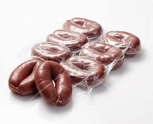 Grützwurst (German blood sausage), partly in the packet