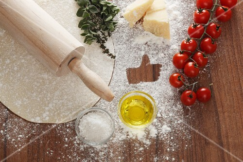 Ingredients for a margherita pizza, with a 'like' symbol
