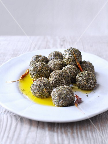 Balls of yoghurt cheese coated in herbs, with olive oil