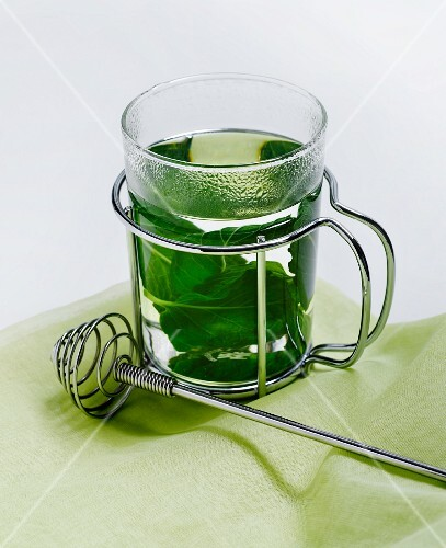 A Glass of Mint Tea with Fresh Mint Leaves