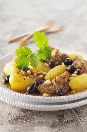 Lamb tagine with potatoes, olives and pine nuts