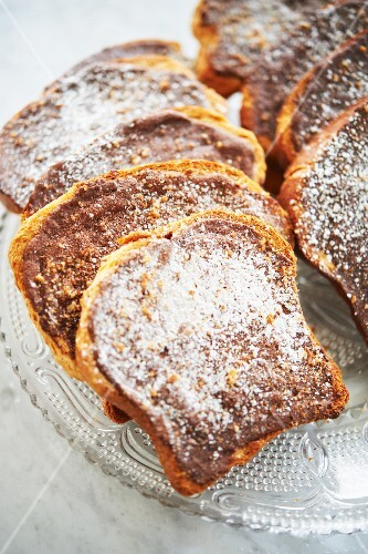 Pain Perdu Topped with Hazelnut Spread and Powdered Sugar