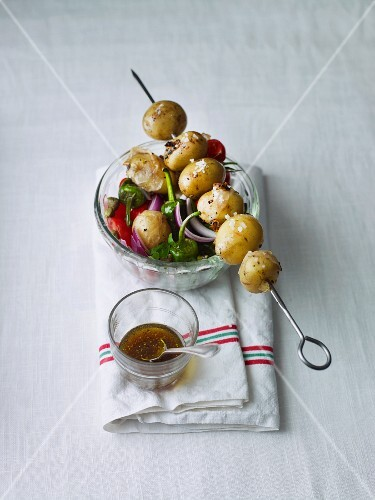 Potato salad with a skewer of potatoes