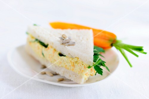 Sandwich triangle filled with tofu and carrot spread and parsley