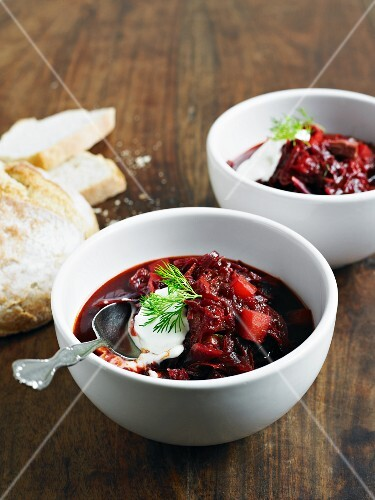 Borscht with sour cream, dill and bread