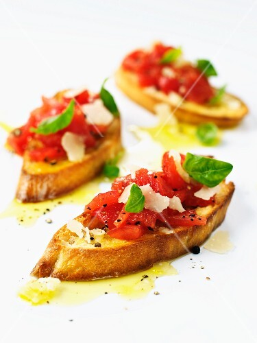 Bruschetta with tomatoes, basil and parmesan