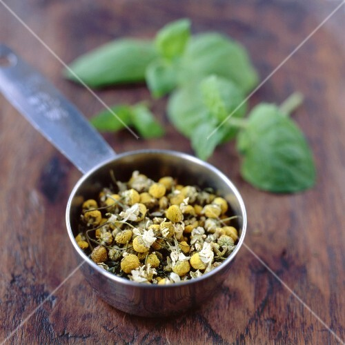 Chamomile and Mint Tea Leaves in Strainer
