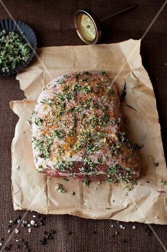 Uncooked Lamb Roast Seasoned with Herbs