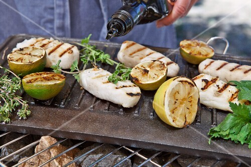 Cod fillets cooked on the barbecue