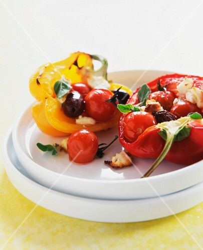 Stuffed peppers with cherry tomatoes and olives