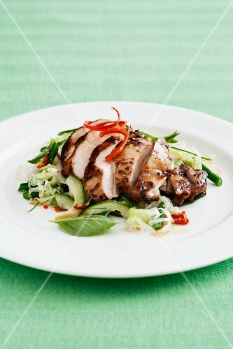 Sticky chicken (marinated chicken breast) on a bed of salad