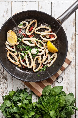 Fried squid rings with lemon, chilli and herbs
