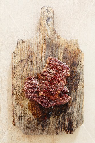 Raw spiced beef on a chopping board