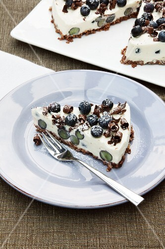 A slice of blueberry cheesecake with a muesli base
