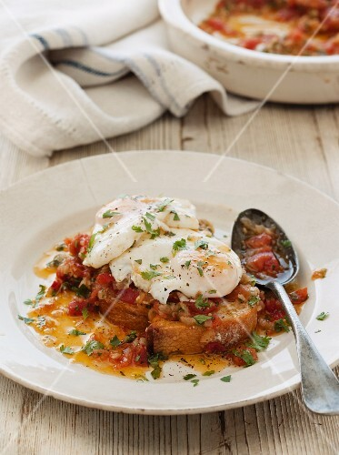 Acorda de tomate with onion sauce and poached eggs (Portugal)