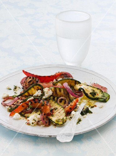 A plate of grilled vegetables with feta