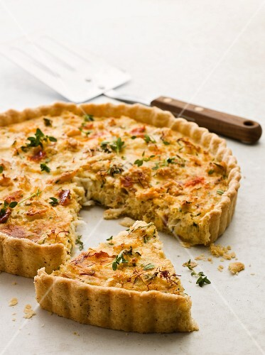 Crab tart with thyme, one slice cut
