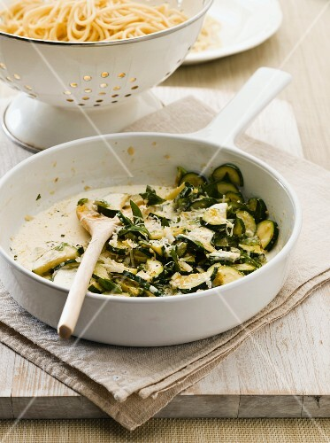 Courgettes with basil as a sauce for spaghetti