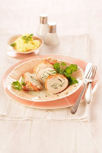 Chicken roulade with herby quark filling, served with mashed potato