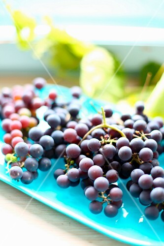 Fresh red grapes on a serving plate