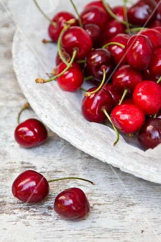 Fresh cherries on a stone plate