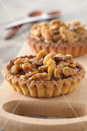 Walnut tartlets on a chopping board