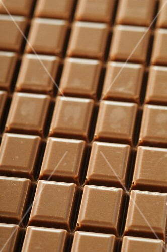 A bar of milk chocolate (filling the image)