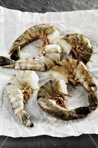 Fresh king prawns on paper