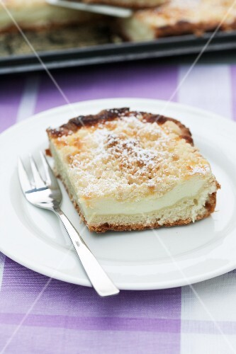 Tray-baked cheesecake with buttery crumble topping