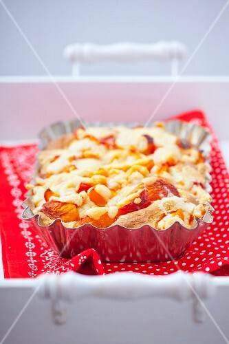 Apricot cake on a red cloth