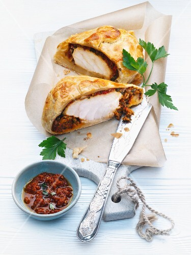 Fish Wellington with monkfish with a pastry crust and pesto rosso