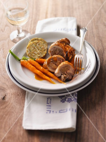 Stuffed pork rolls with carrots and napkin dumplings