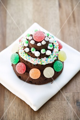 Chocolate cake with pumpkin and ginger; decorated with gum drops