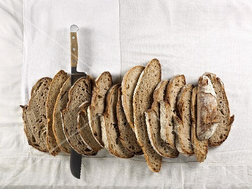 Slices of brown bread made from mixed rye and wheat flour, lined up together