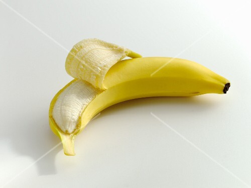A partly peeled banana