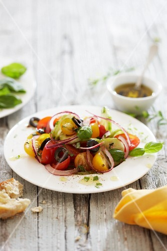 Colourful tomato salad with black olives