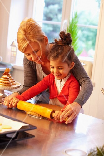 A mother and daughter rolling dough for Lebkuchen (spiced soft gingerbread from Germany)