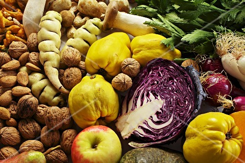 Autumn still life featuring fruit, vegetables, mushrooms and nuts