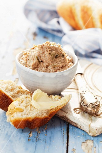 Tuna pâté with white bread on a blue wooden surface