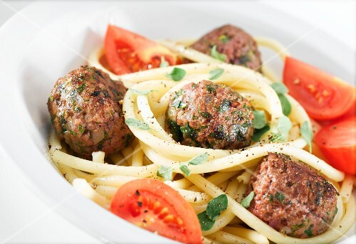 Meatballs with macaroni and tomatoes