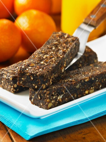 Home-made muesli bars with oranges