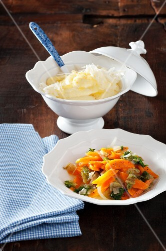 Polenta with cheese and a medley of chicory and carrots (South Tyrol)