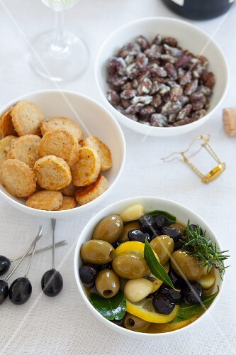Olives, cheese crackers and salted almonds